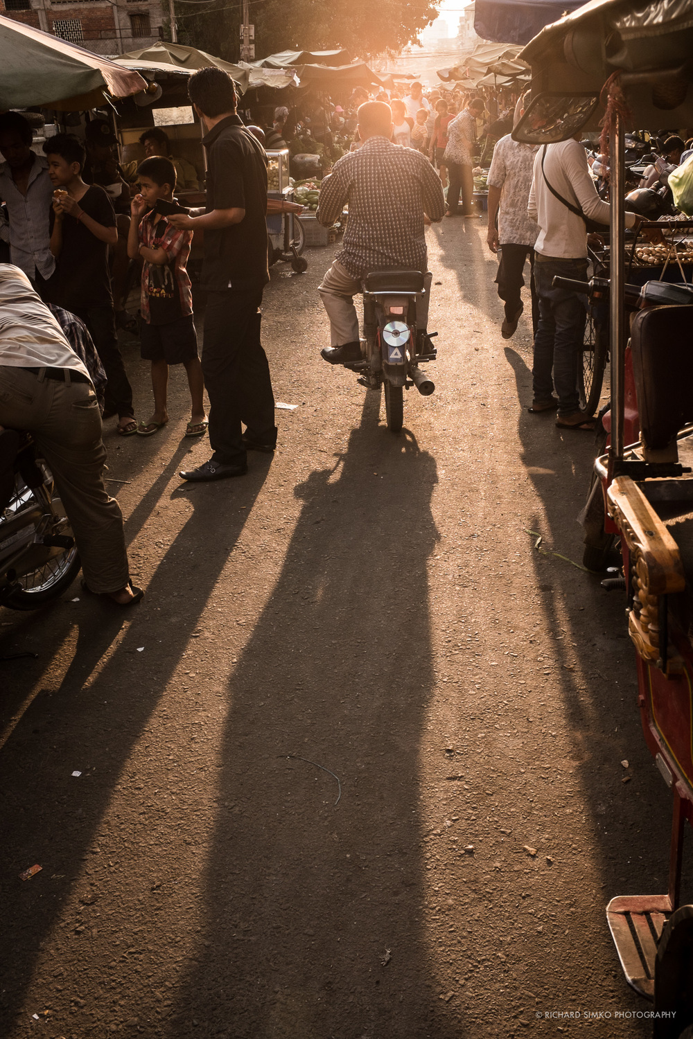 Long shadows just before sunset. Kandal market, Phnom Penh