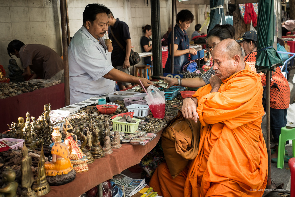 Buddhist monk and amulets