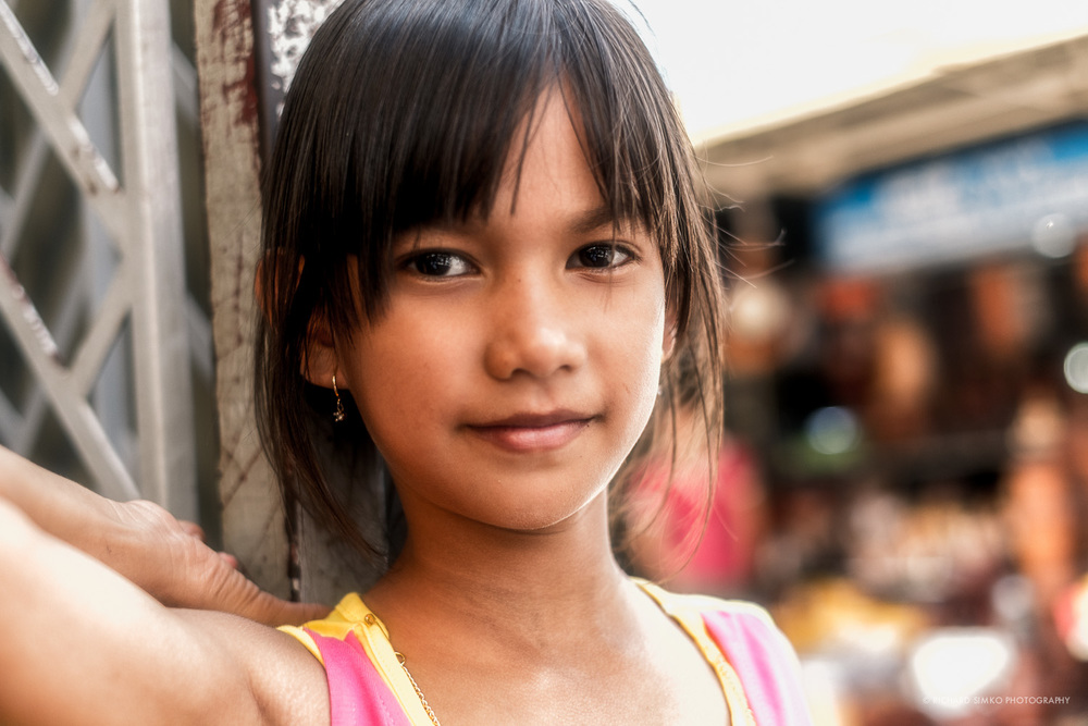 This is a very special photo for me. This is Srey Vy, little Cambodian girl that I am sponsoring through Cambodian Children Fund. This was taken on the day we met in person first time. After a day on playground, restaurant and shopping I can see a spark of happiness in her eyes. Finally she had chance to do things that she was denied due to poor background she came from. She looks more quite mature on this photo considering her age. It was also one of the best days of my life for me too.