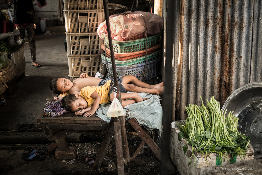 In this photograph everything came together. Two little boys sleeping in one of the Phnom Penh's market in late afternoon. Sun was slowly going down and at one point narrow beam of barely visible light kissed the boys. Moment that lasted only a fraction of the second as the place was quite crowded. I quickly had to keep moving. This picture represents the childhood innocence for me.