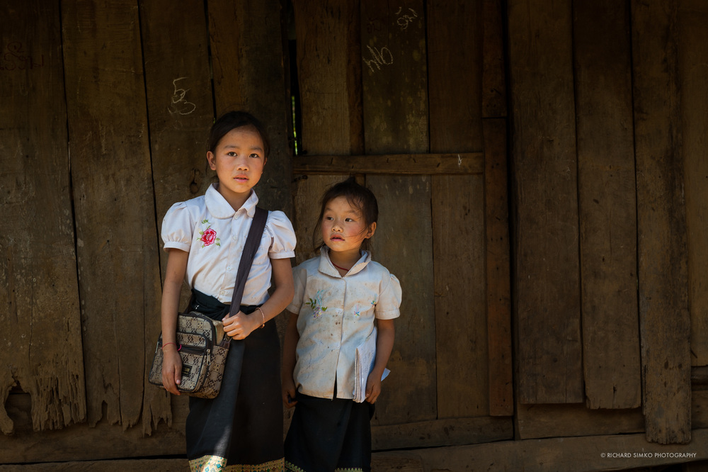 I met these two young ladies during my trip to remote H'mong village in Laos. We passed by few local schools, really a few shabby wooden shacks. They were nicely dressed and looked very happy. As this was relatively new route, we were one of the first western people they have come across, hence a little scary look in their eyes. But few minutes later they opened up and after school they followed us everywhere we went.