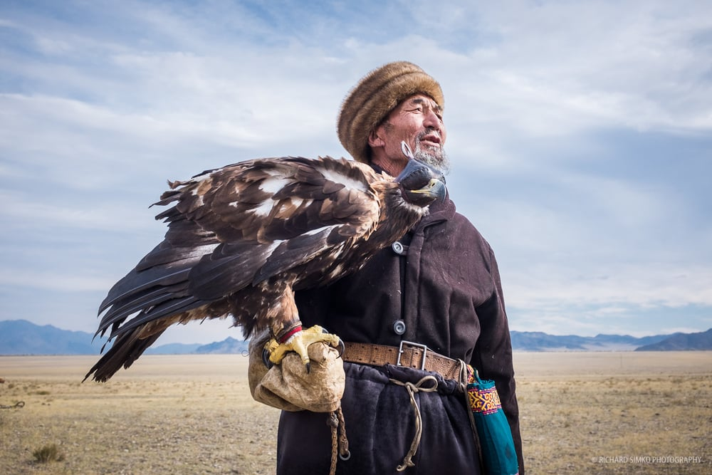 Kazakh eagle hunter. This photograph, in my opinion describes this ethnic minority living in Bayan-Olgii province in Western Mongolia. They stand tall, proud and beautiful. Eagle hunting has long lasting tradition among Kazakhs and it is remembered on annual eagle hunting festival that takes place in city of Olgii.