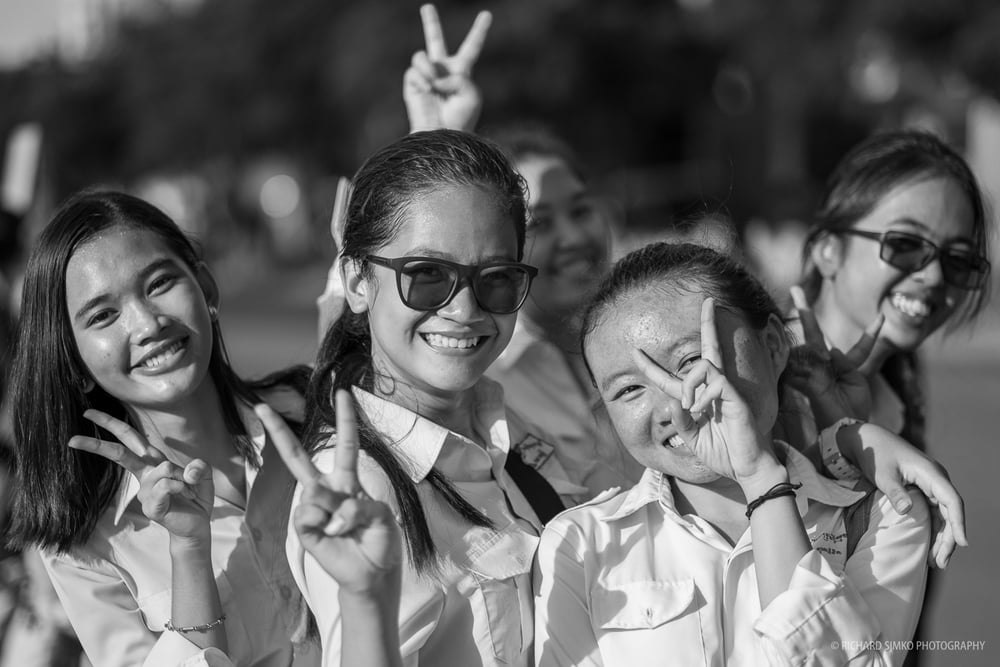 When I look at this photograph I see the future of Cambodia. These young students are waiting for appearance of his majesty the king of Cambodia. They gave me this pose when I was walking by. Nearly 100% of all educated people were killed of during Khmer Rouge regime. That would be a huge loss to any country. Educated youth is what Cambodia needs and this picture tells me the country is on a good way to better future.