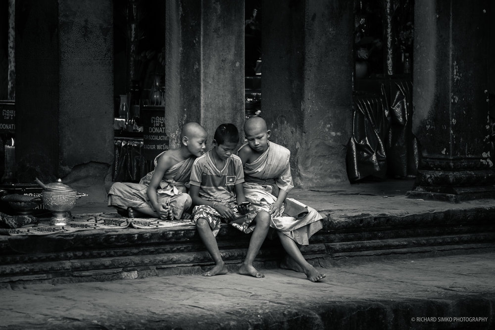 Angkor Wat is probably one of the busiest tourist destinations in world. Therefore, it is quite challenging to get a shot with no tourists in the frame. As much as I would like to shoot this scene with wider lens and much closer to the subject, the longer telephoto allowed me to capture a clean undisturbed frame of these young monks with heir friend. Looks like mobile phones are taking over even the holiest of places.