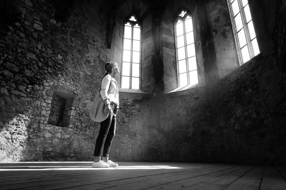 Trying to be creative shooting inside Beckov Castle ruins.I positioned my sis right in the beam of light coming from window and I shot it from a low angle.