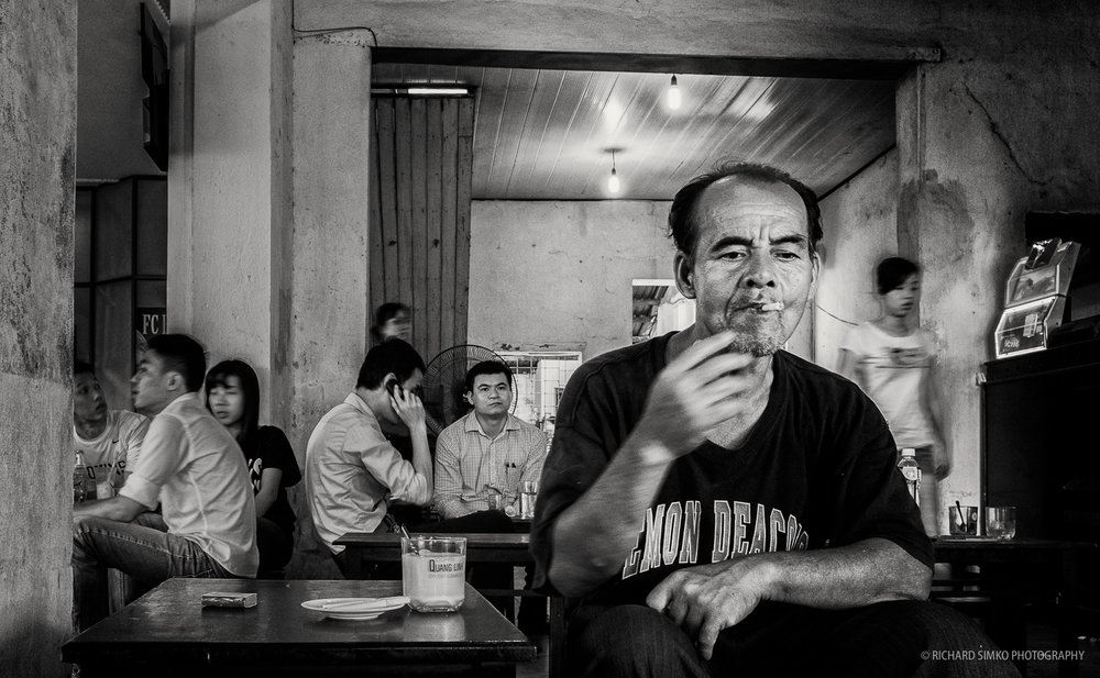 Man in Vietnamese coffee shop, Fujifilm X100S
