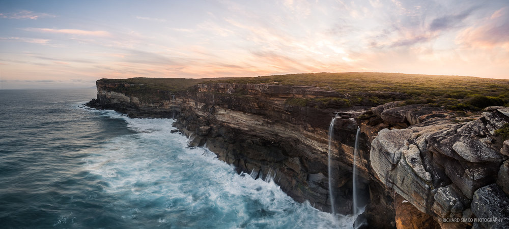 This stitched panorama was taken from Eagle Rock in Royal National Park south of Sydney. The two stream waterfall ads lots of drama to already dramatic sea. Shame the water levels in the river were low. It was a nice experience and evening of shooting nevertheless.