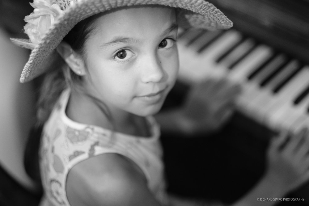 We had a small reunion with my former colleagues and friends back home in Slovakia. My friend Mia came with her daughter and we went to my other friend Martin's photo studio. I noticed a potential for a good photo when little girl sat next to piano. Room was quite dark so I opened the aperture and set the ISO quite high. I think the photo came out great. The Acros film simulation was perfect for this scene and subject.