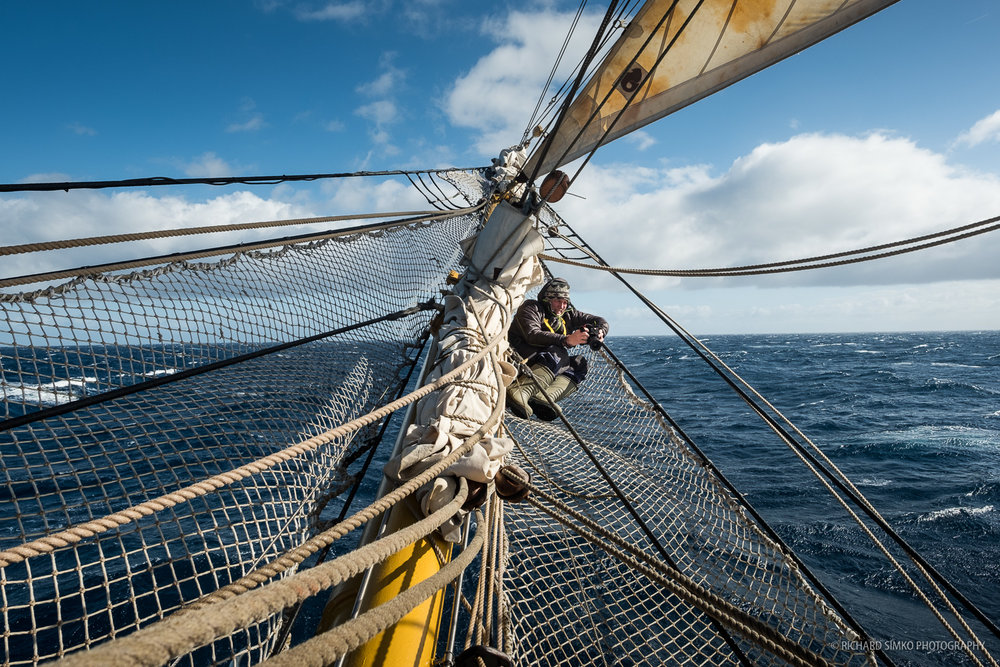 Valery Vasilevskiy sitting in the best hammock in the world. At bowsprit of Bark Europa.