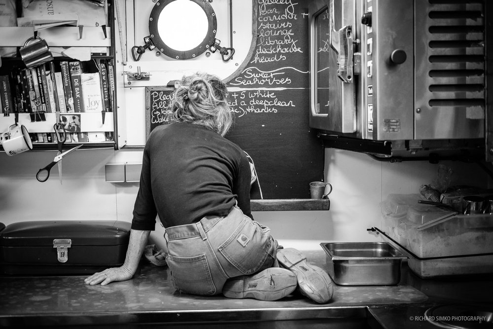 This photograph absolutely had to be here. It was taken in the galley of Bark Europe. Rensje is writing some food-related notes on the board with crayon. I was not waiting for this moment. I was just walking by and I happened to have a camera in my hand. I knew this was a special moment and I snapped a few shots. What makes me happy is the fact that Rensje loved the photograph even though she doesn't like to be photographed. Pat on the back Rich :)