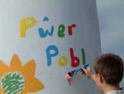 A local lad writing 'People Power' on a turbine tower