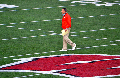 Urban Meyer and the Buckeyes need some help to make it to the big dance. They have a chance of having back to back undefeated season and no titles to show. © GoBucks2 used under CC BY-SA 2.0