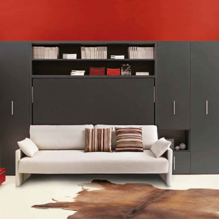 The Circe sofa module comes with built in display and storage above and can be integrated with other storage display modules for a clean clutter free wall in a living area.