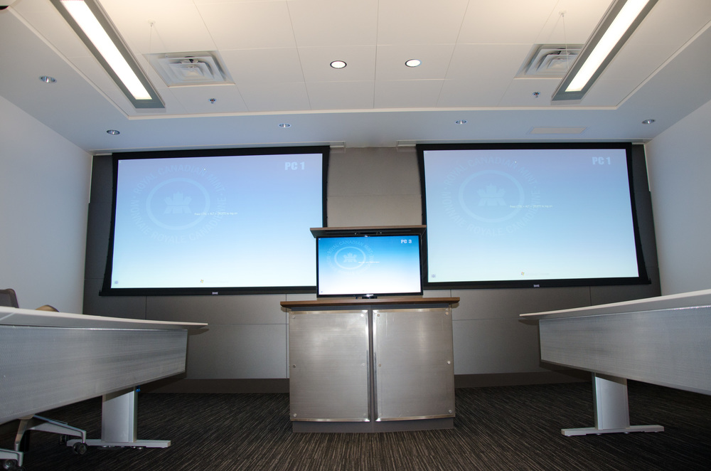 Opposite end of Conference Room allows for dual screens for English and French presentations, as well as video presentations from a speaker anywhere in the world.