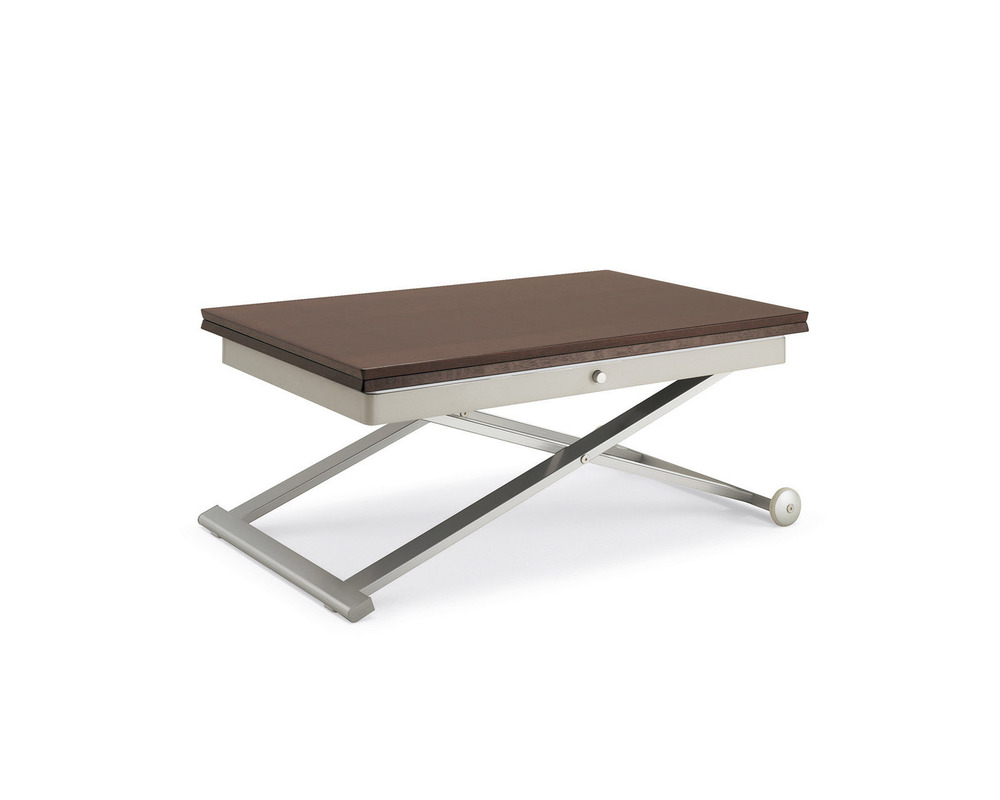 The Flexy table in metal and wood as coffee table. Press the button and the height adjusts! Flip open the top and swivel it 90 degrees to double the size!