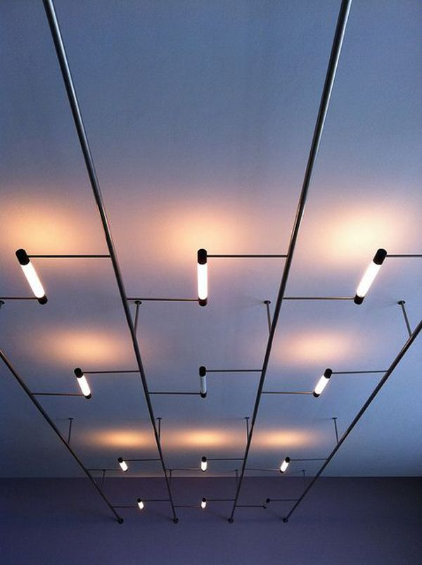 Lighting can be used to create a sculptural element on the ceiling. This modular light system has been configured to provide both general illumination in the room and pools of accent light on the ceiling. Effects are ever changing depending on which lights are on.