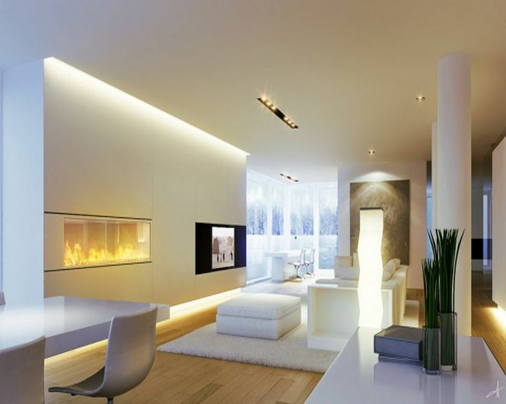 Several sources of light in this living space create light zones. Some of the walls are built out to provide a recess at the base for indirect lighting and a light cove at the top of the wall. This gives the room a lot of depth, making the walls appear to float. Accent lighting is provided by recessed swivel spot lights in the ceiling. These lights can be directed to focus on any item in the room and allow the client to change the patterns of light in the space easily. The floor lamp provides both a light source and a sculptural element in the centre of the room.