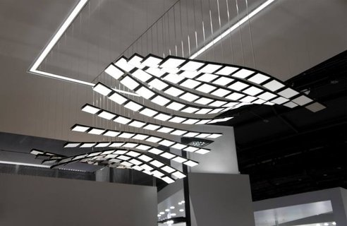 "Manta Rhei from Art Com and Selux. The light ""tiles"" can be choreographed to move in various, beautiful ways. The design is based on OLED technology, a lighting technology that allows for very thin, very light-weight panels."