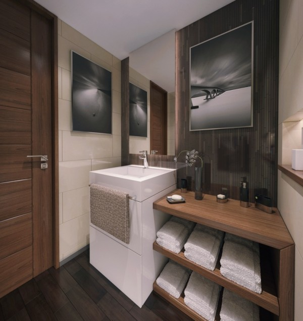 This space is 5' wide. The storage has become completely integrated into the design of the space. Two fully functioning drawers under the sink provide much more accessible storage than a door cabinet. The partially recessed mirrored wall cabinet provides soft lighting on three sides and opens to a mirror behind shelves. Towel bar mounted on the sink means towel is always handy for wet hands! The open wood shelving hold a week's worth of bath towels and provides ample counter space. Notice the wood ledge built into the wall with lighting...perfect for objet d'art!!