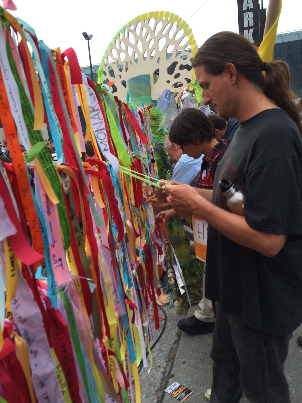 People choosing climate ribbons to take home, Peoples Climate March, NYC