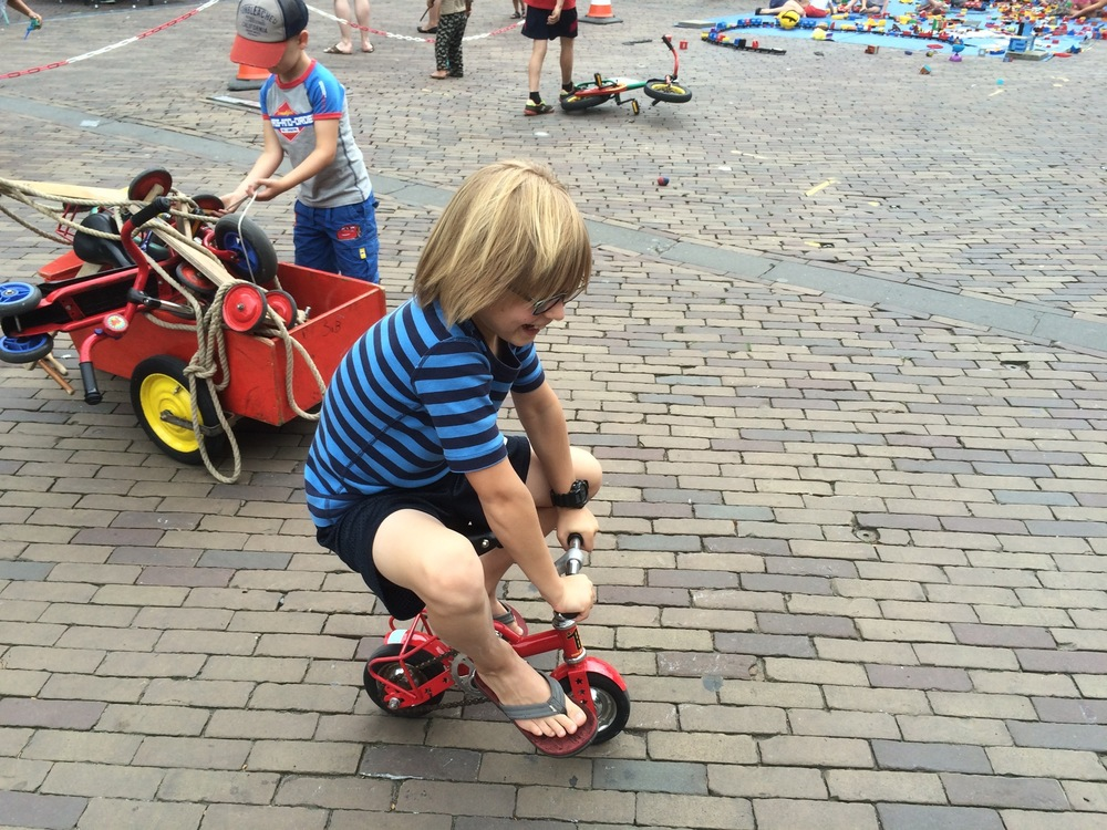 Elliot rides a tiny bike. Deventer, Netherlands.