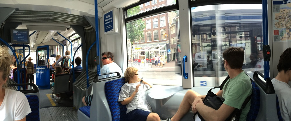 Elliot and his dad enjoy another tram ride in Amsterdam. Note the on-board ticket booth in the back. Trams have both a driver and a separate ticket vendor.