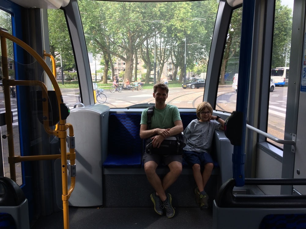 Elliot and his dad on the back of a tram in Amsterdam.
