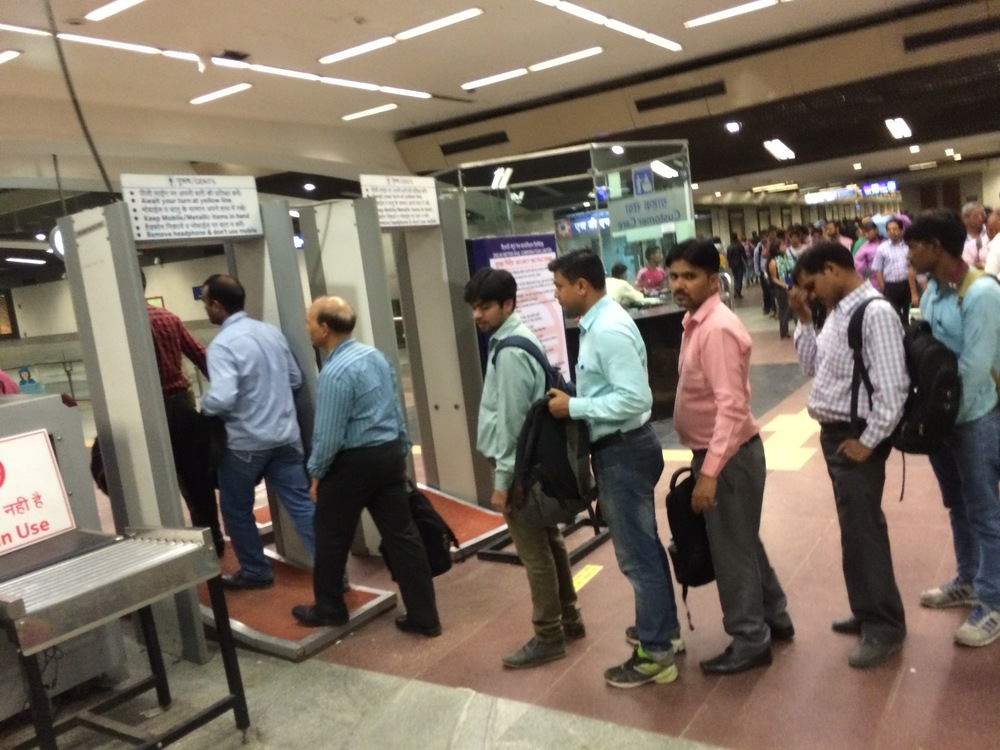 Lines to get on the New Delhi metro, stretching into the distance.