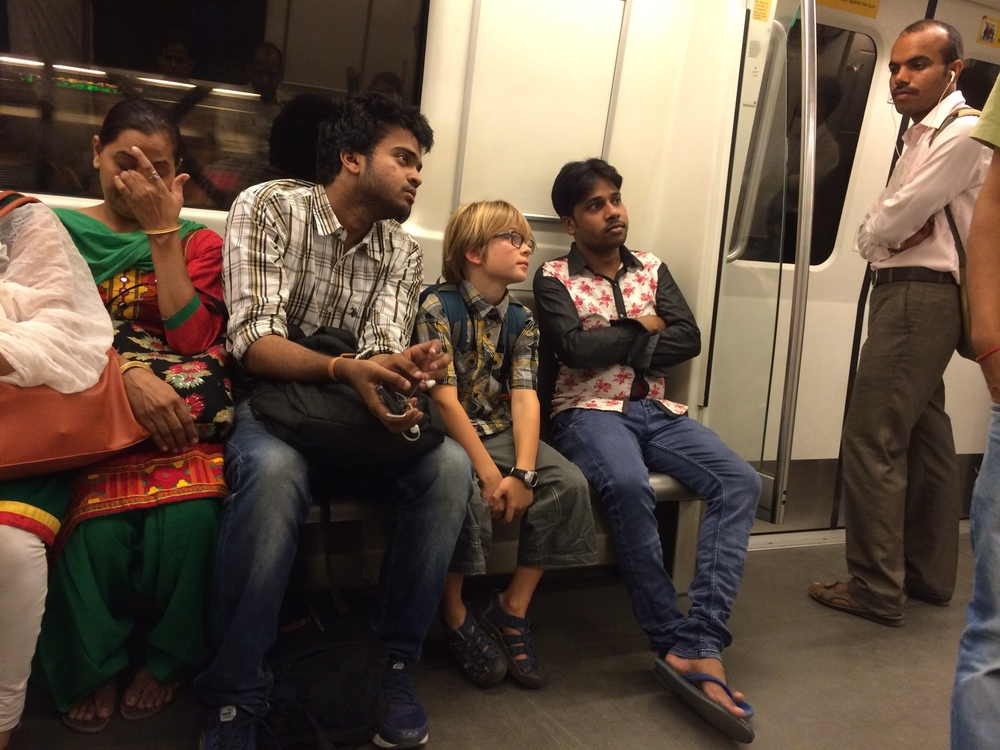 Elliot makes two new friends on the New Delhi metro.