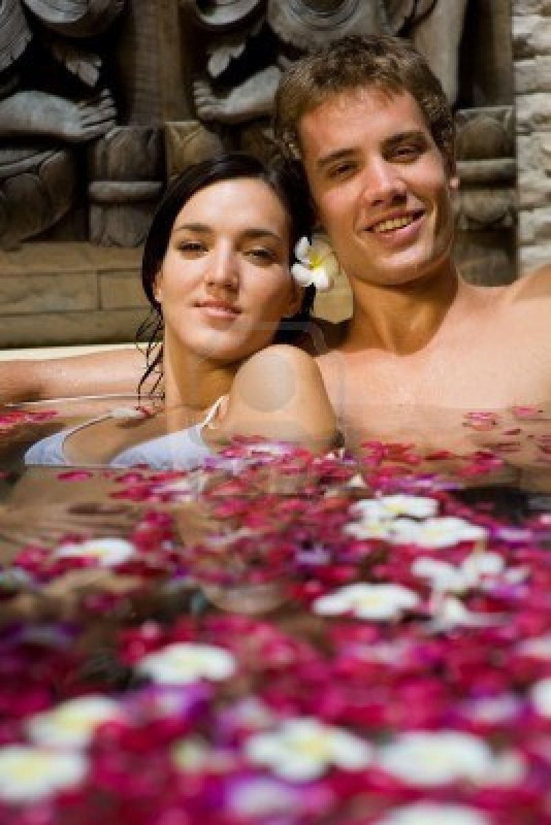 3564927-a-young-couple-together-in-a-bath-with-petals-and-flowers-at-a-tropical-spa.jpg