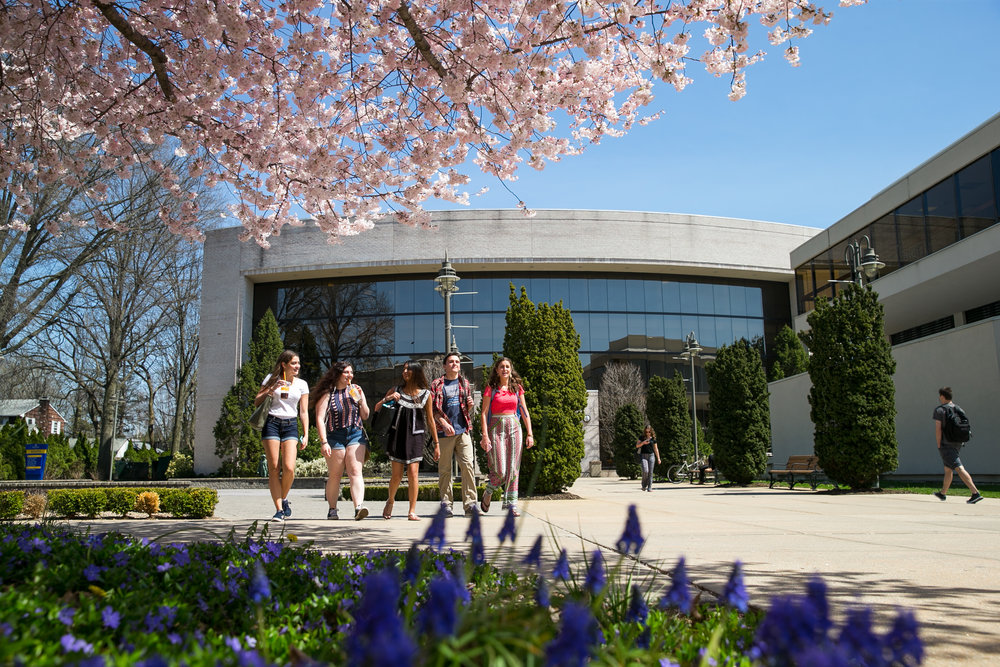 The first 75* Spring day at Hofstra University had students out and about.