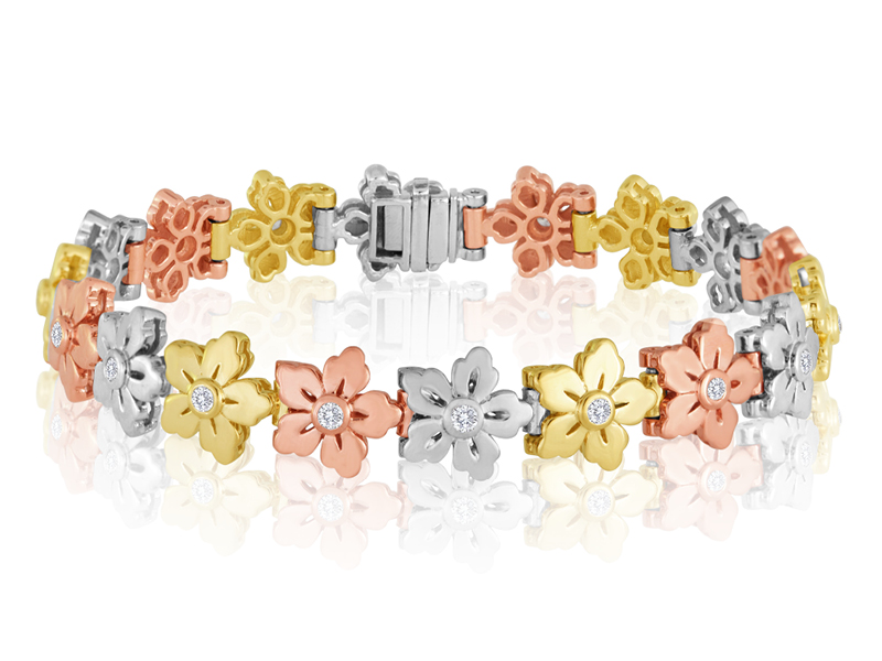503 complete  Our .03 CT TDW blossoms are available assembled with our 502 stems or as shown here on their own. This bracelet looks especially good in a tri-tone pattern.