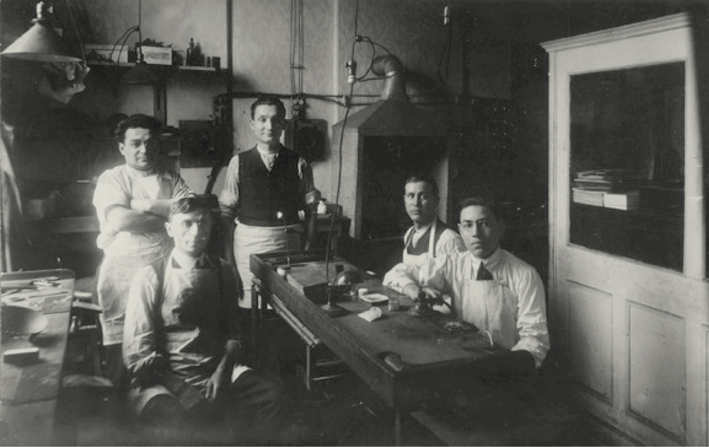 Barnett Esh (on left with arms folded) in first K&E factory 1917