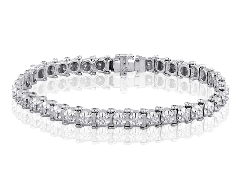 864  The original four-prong tennis bracelet.  Each link features a .06 CT G-H color, VS2 diamond.  The styling is timeless, the quality is heirloom, and the piece is something that every woman should own.  39 links make a finished length of 7 1/4 inches.  This is the perfect gift for Grandma and Grandpa to endow for their special girl because, like their love, it will grow with her.  And unlike other bracelets on the market, this is one the not only will she wear for her whole life, but will be able to pass on to her children when the time is right.  Available in 14K white, yellow and pink gold, and in per link diamond weights up to and including 1/4 CT.