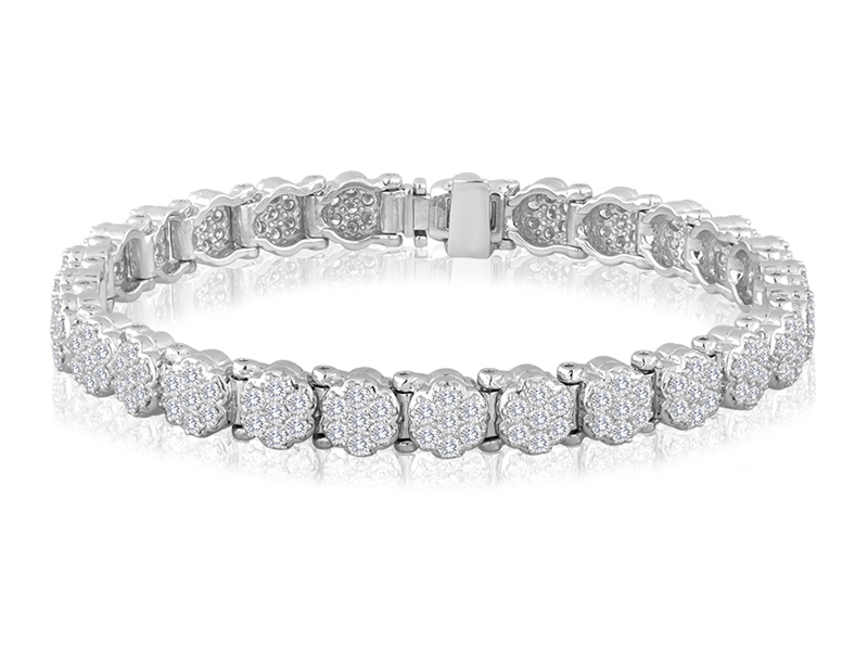 709  The 709 link features a seven stone cluster of 1.9mm diamonds yielding a per link total diamond weight of approximately .21CT.  These diamonds are set by us here in New York to assure that they 'face up' properly and in such a way as to truly display the brilliance of fine diamonds.  The complete bracelet takes 28 links for a 3 3/4 CT TDW.  Please keep in mind that we also make a 'large' version of this link with 2.4mm diamonds instead of 1.9mm.
