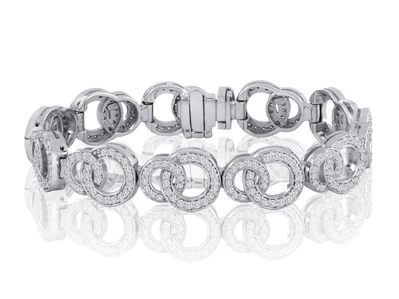 915  The 915 features interlocking big and little 'O's for an almost art-deco look. This bracelet is newly available with plain-gold links to mix with our traditional 1/3 CT TDW diamond links.