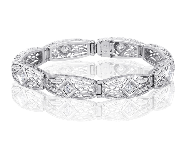 952  The 952 is the largest of our filigree styles. Each link features one G-H color, VS2 diamond at .09CT each. The standard finished length of this bracelet is 8 links making almost 3/4 CT total when complete.
