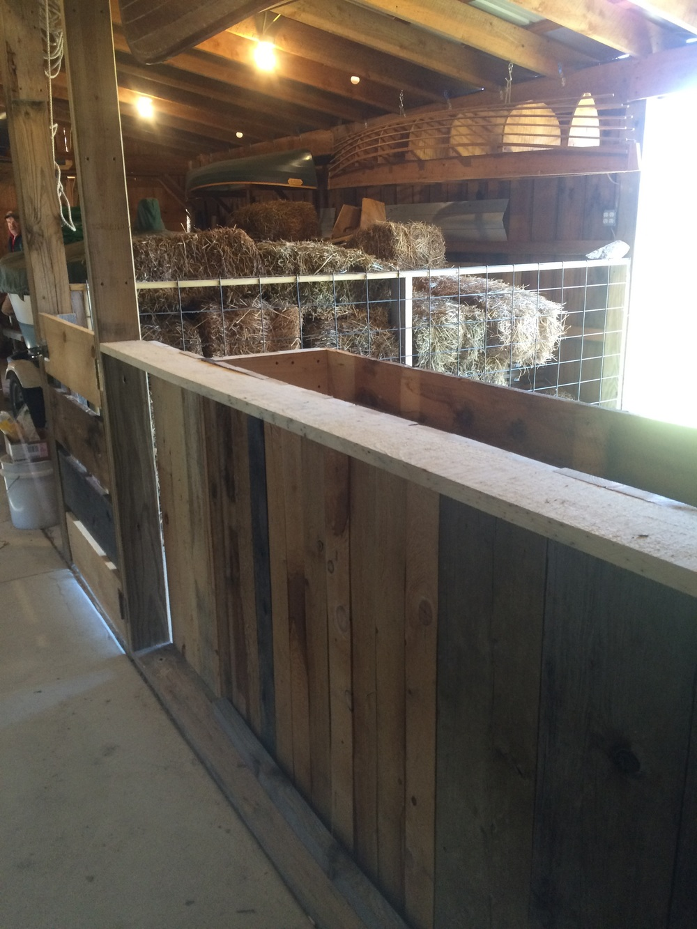 High stall walls should keep separated sheep in place.