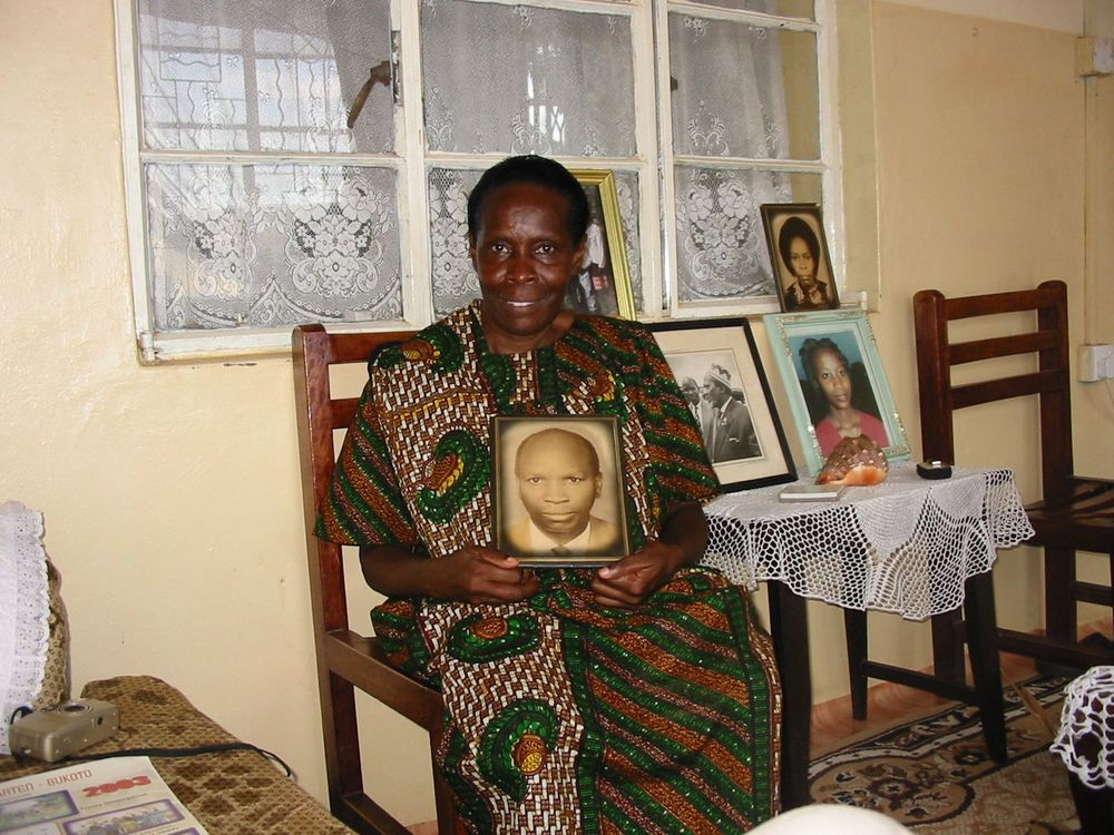 Joyce Laki with her father's portrait (Andrew Rice)