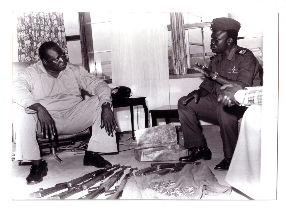 General Idi Amin receives a briefing on subversive activities from his loyal subordinate, Yusuf Gowon. (Radio Uganda)