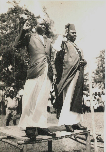 Eliphaz Laki (left) and James Kahigiriza stand together at Laki's swearing-in as a chief, circa 1963. (Laki family)