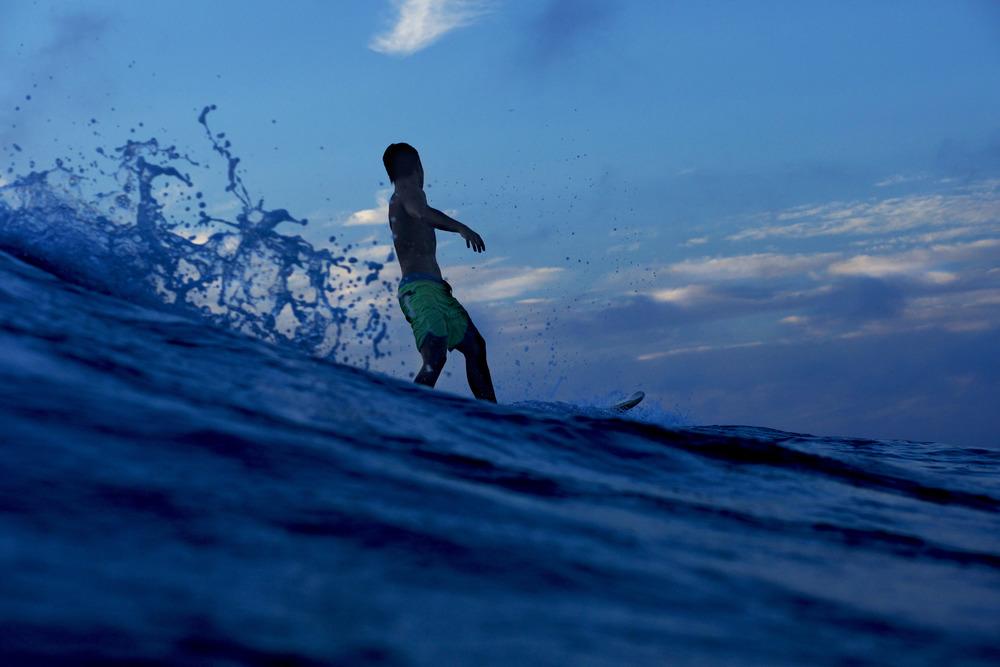 SurferExitsWaveDusk01.jpg