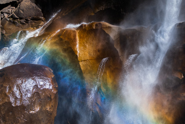 Rainbow Frog.  Photograph by Terrence Robertson-Fall.   The waters of Vernal Falls in Yosemite National Park course through layers of rocks, throwing up a mist caught in the sunlight and creating a rainbow of color.  In the midst of the action, the rock, water and light create the likeness of a frog.  Can you see it?