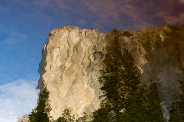 Liquid Granite.  Photograph by Terrence Robertson-Fall.  El Capitan in Yosemite National Park stands tall and mighty - on most days.  Here, in the reflection of the Merced river, rippling in a soft breeze, it flows like water.