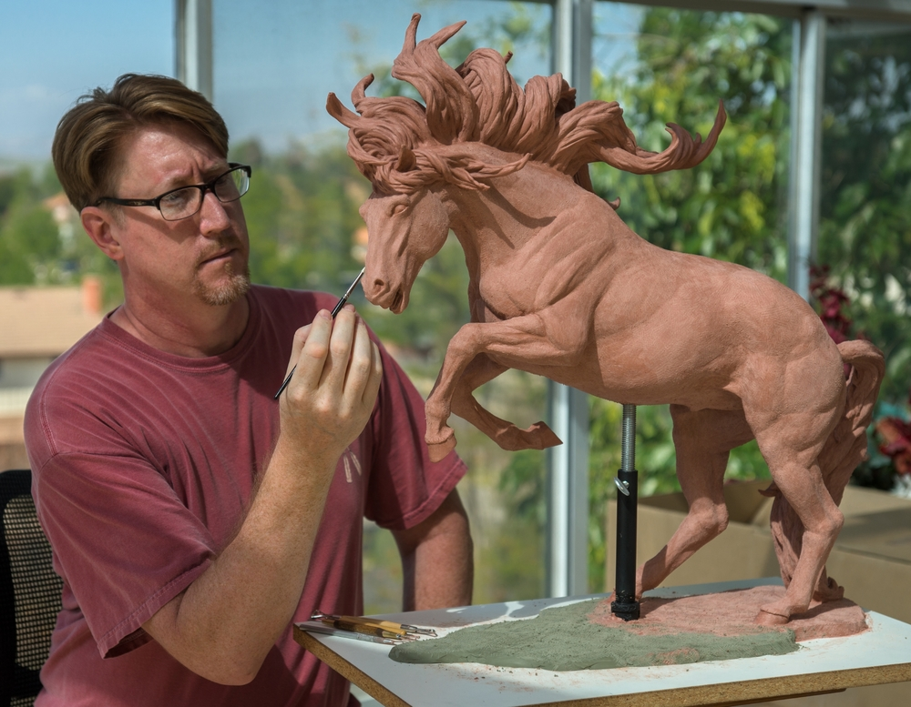 Terrence sculpting Running Free Horse