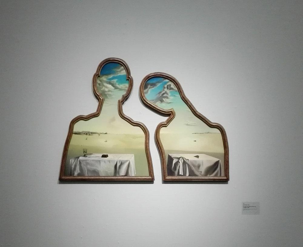 Salvador Dali, Een paar met het hoofd vol wolken, 1936.