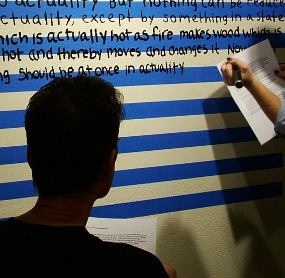 MCB creates  A Postmodern Meditation on the Five Proofs of God:   Quinque viae (Proof 1)  with art students from Catholic University of America directly upon a wall in Salve Regina Gallery; November 2010.
