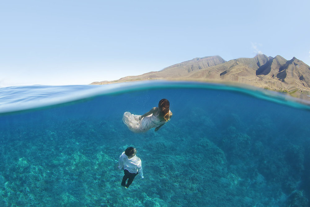 Underwater wedding photography. Silke, beaded pink wedding dress. Hawaii. Trash the Dress. Maui. Clear water. Free Divers. Destination wedding.