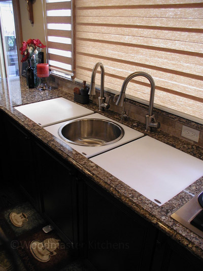 Kitchen design featuring the Galley Sink with cutting boards.
