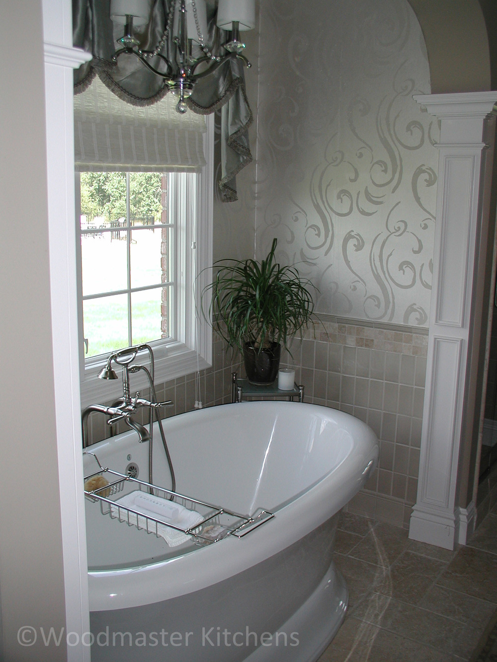 Freestanding tub design with a pedestal base.